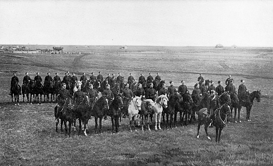 The group of North-West Mounted Police on parade in Regina, Saskatchewan (the North West Territories at the time) sent to the 2nd (Special Service) Battalion, Royal Canadian Regiment of Infantry for the Second Boer War in South Africa. Vintage etching circa 19th century.