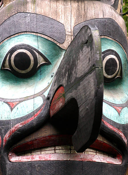 Northwest Native American totem pole face stock photo