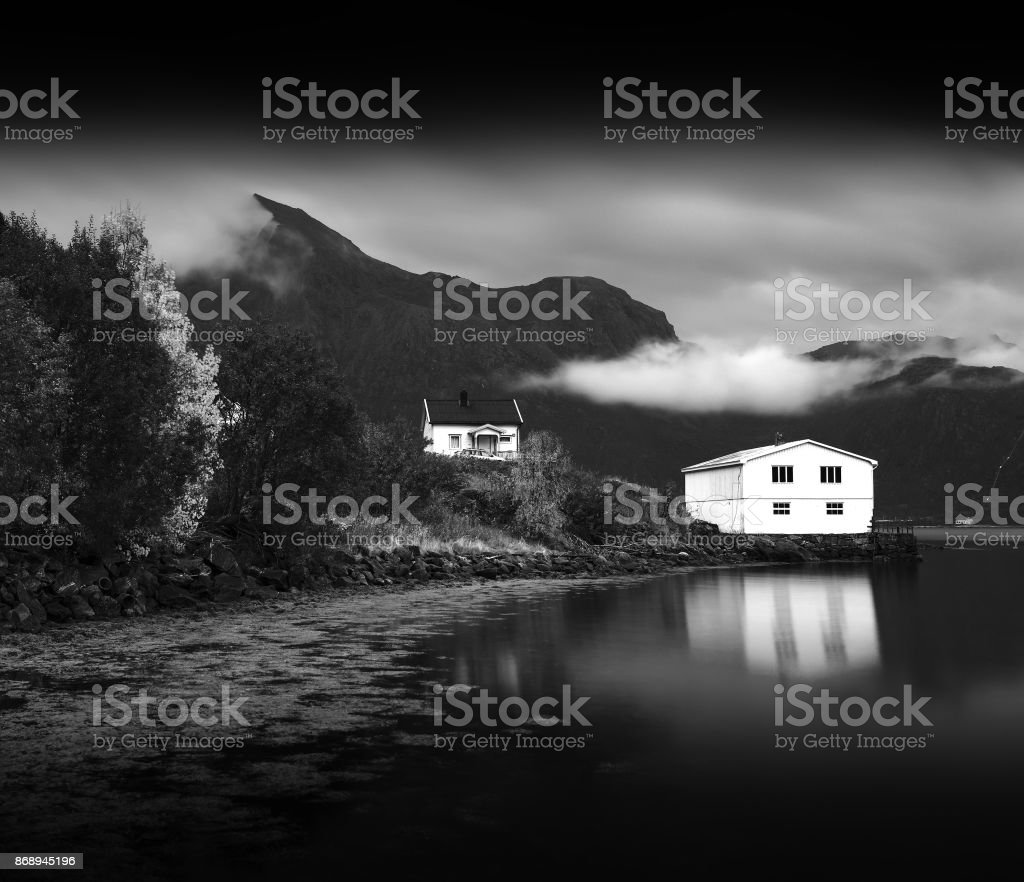 Norway cabin with water reflections stock photo