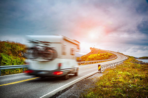 norway. caravan car travels on the highway. - caravan stockfoto's en -beelden