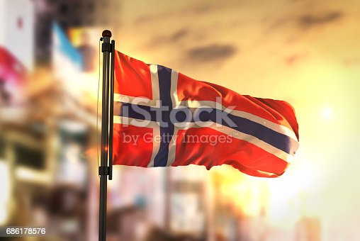 istock Norway Flag Against City Blurred Background At Sunrise Backlight 686178576