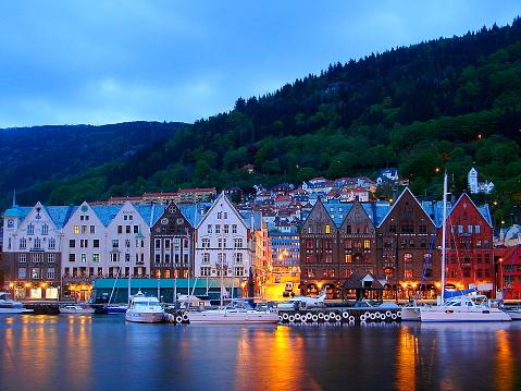 Norway: impressive Bergen Cityscape: Bryggen market bay at dusk, Norwegian dramatic landscape, Scandinavia – Nordic Countries