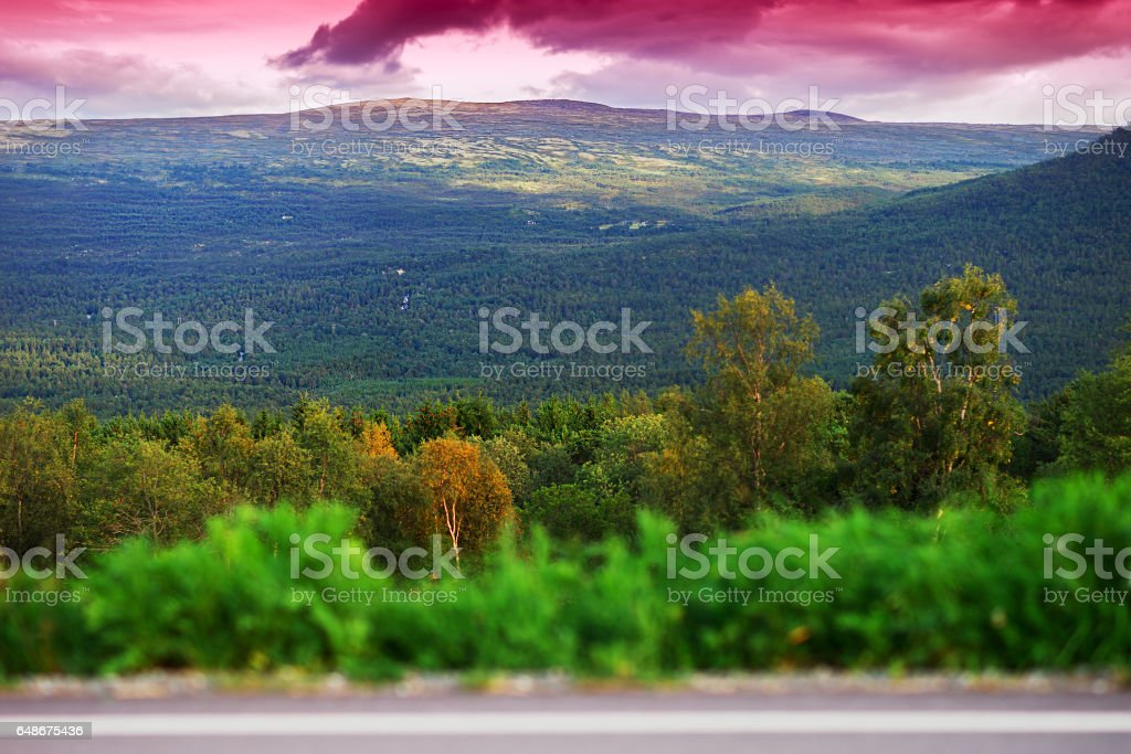 Norway mountain transportion road with bokeh and pink sunset bac stock photo