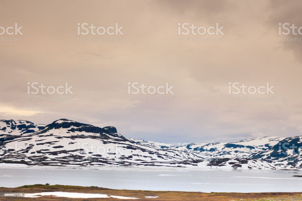Norway scenic mountains with frozen lake. 免版稅 stock photo