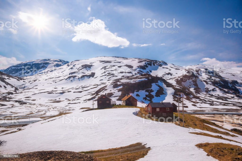 Norway with colorful wooden houses against waterfalls during spring time. Railroad from Flam to Myrdal in Norway stock photo