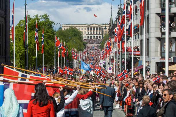 Norway's national day is celebrated. Norwegians celebrate May 17, National Day at Karl Johans gate, Oslo, Norway. May 17, 2005. oslo stock pictures, royalty-free photos & images