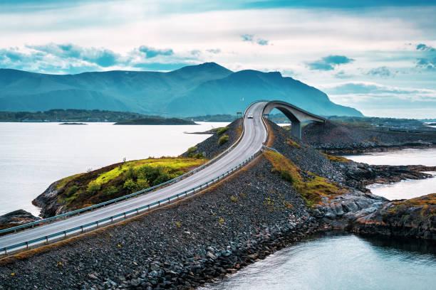 Norwegian atlantic road bridge World famous Atlantic road bridge (Atlanterhavsvegen) with an amazing view over the norwegian mountains. atlantic ocean stock pictures, royalty-free photos & images
