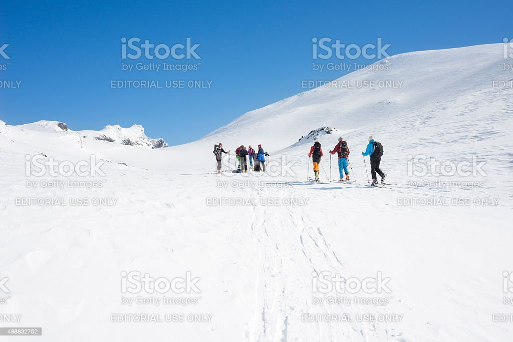 Norwegian backcountry skiers are ascending Mount Galdeberget in Jotunheimen stock photo