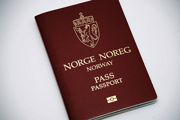 Norwegian biometric passport Regular Norwegian passports are burgundy in colour, with the Norway Coat of arms emblazoned in the top of the front cover. The new biometric Norwegian passport has the standard biometric symbol at the bottom. norwegian culture stock pictures, royalty-free photos & images