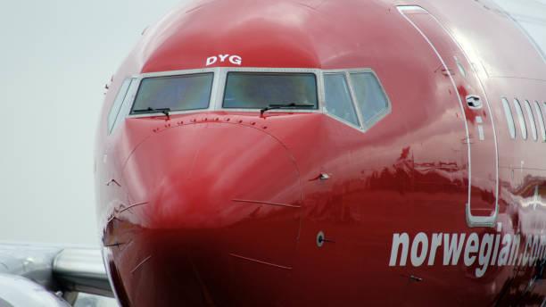 Norwegian Boeing 737 airplane arriving at the gate in Berlin Schonefeld airport SXF stock photo