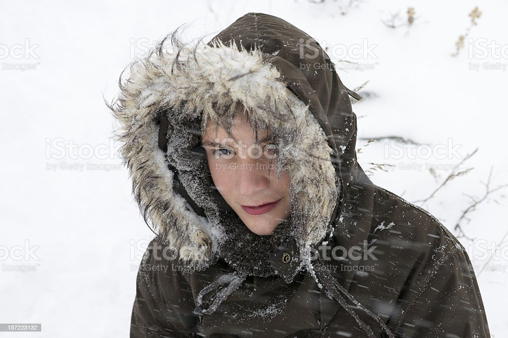 Norwegian boy in snow storm dressed for mountain skiing stock photo