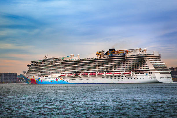 Norwegian Breakaway New York City, New York, USA  - November 16, 2014:  Norwegian cruise ship, Breakaway, leaving New York Harbor.  Norwegian Breakaway is home ported at the New York Passenger Ship Terminal in Manhattan and was launched in 2013. norwegian culture stock pictures, royalty-free photos & images