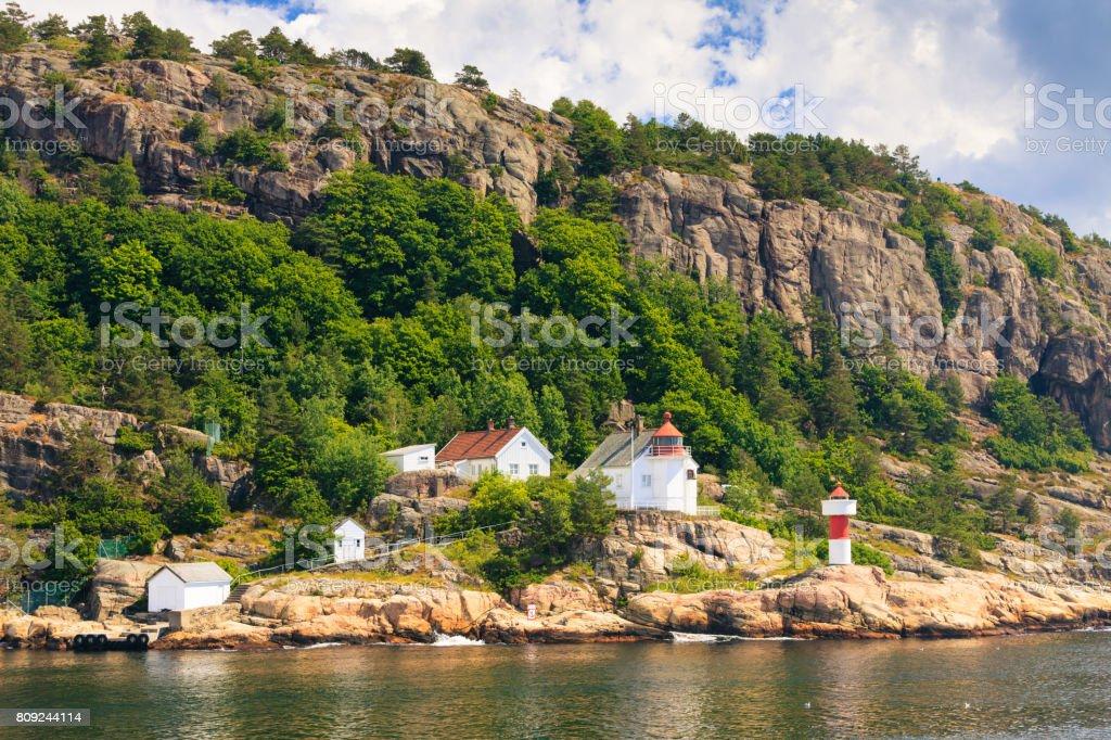 Norwegian coastline with lighthouse stock photo