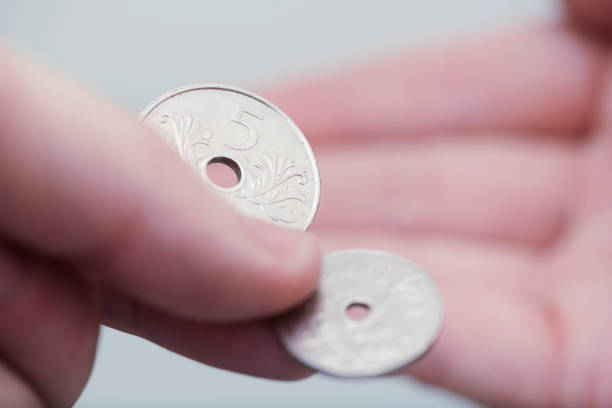 Norwegian coins being exchanged in hand stock photo
