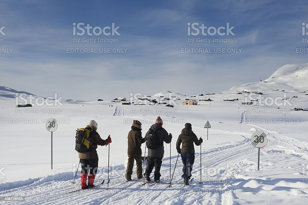 Norwegian family is cross-country skiing in Jotunheimen royalty-free stock photo