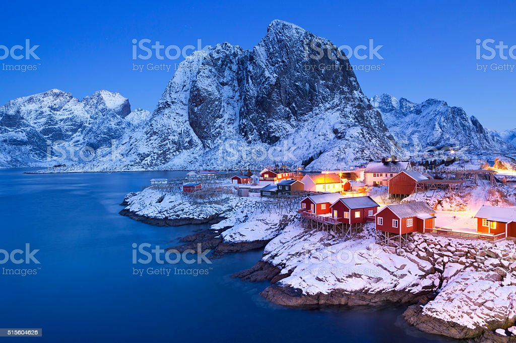 Norwegian fisherman's cabins on the Lofoten at dawn in winter stock photo