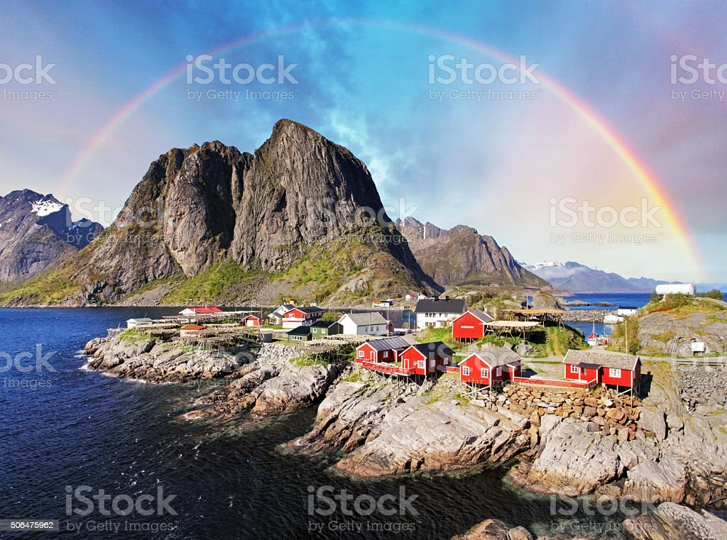Norwegian fishing village huts with rainbow, Reine, Lofoten Islands, Norway stock photo