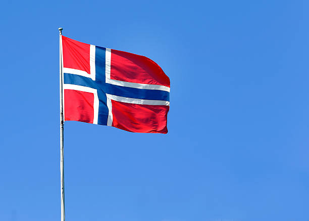 Norwegian flag The Norwegian flag flies in the wind. country geographic area stock pictures, royalty-free photos & images