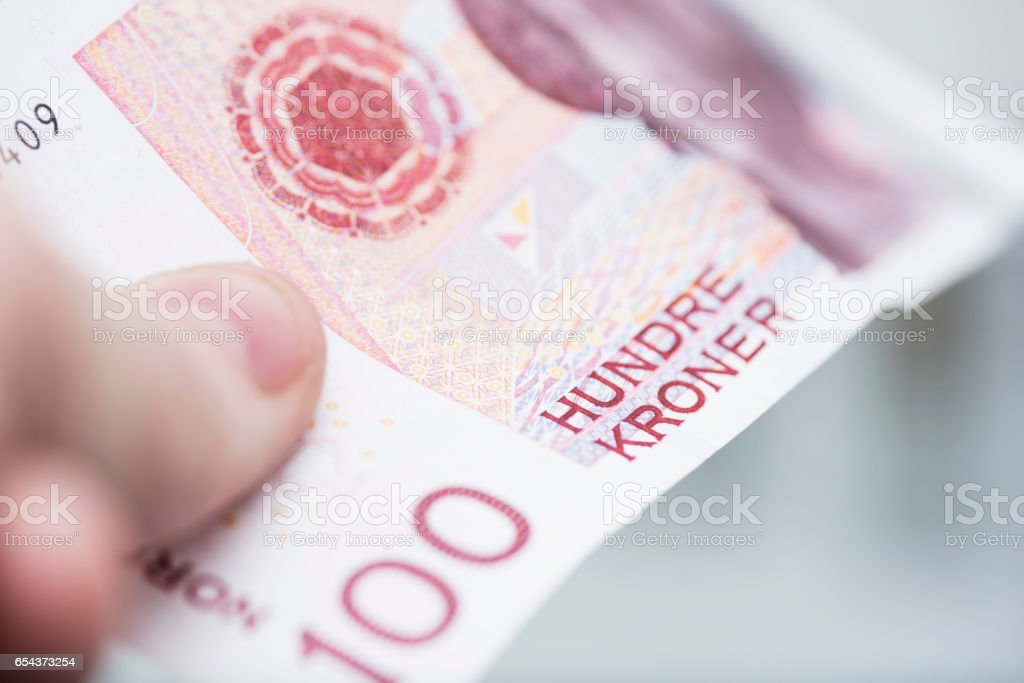 100 (hundred) Norwegian kroner bill macro detail close up. stock photo