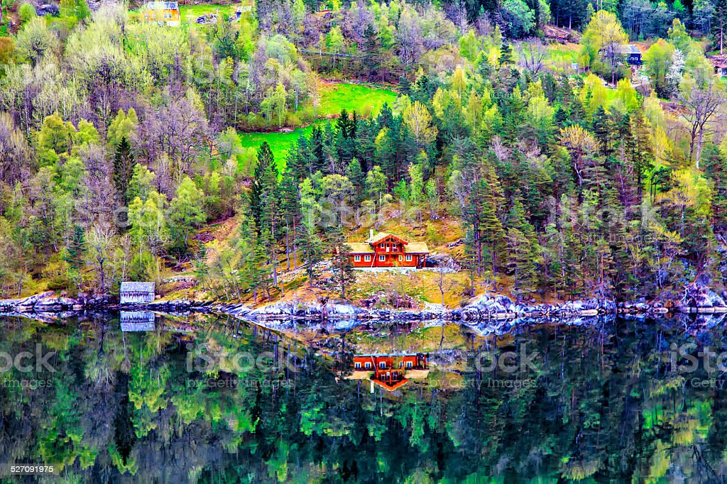 Norwegian landscape: village, mountain and sea stock photo