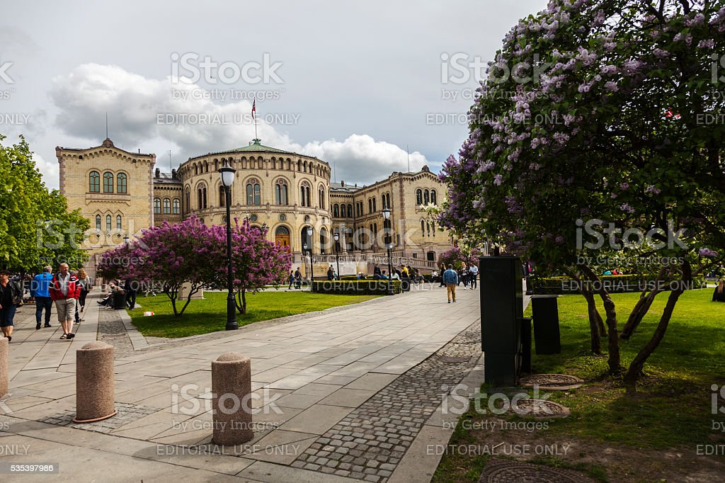 Norwegian parliament bulding with flag on roof in early May. stock photo