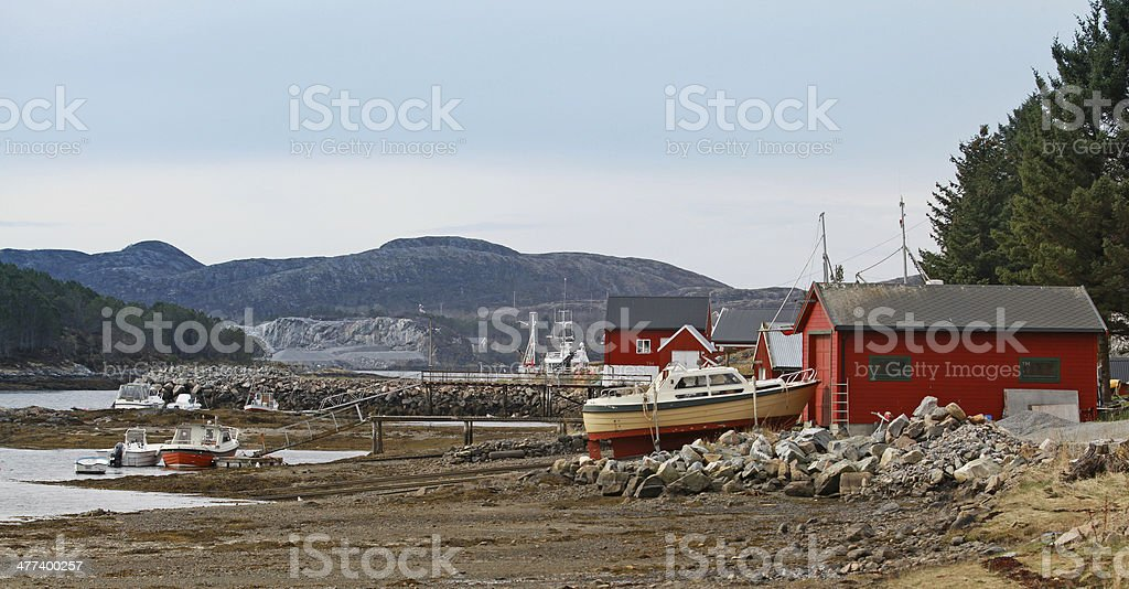 Norwegian red wooden houses and small fishing boats royalty-free stock photo