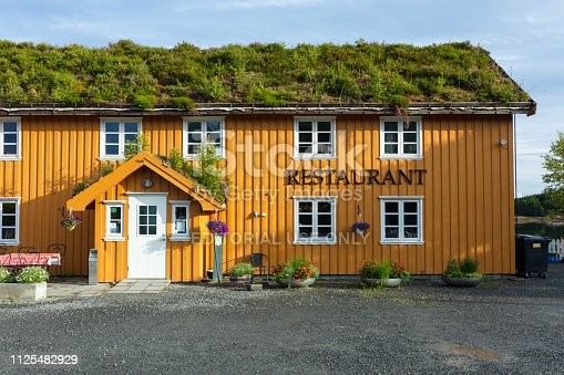 Norwegian style restaurant near the Atlantic road. A sod roof, or turf roof, is a traditional Scandinavian type of green roof covered with sod on top of several layers of birch bark on gently sloping wooden roof boards. Until the late 19th century, it was the most common roof on rural log houses in Norway and large parts of the rest of Scandinavia.