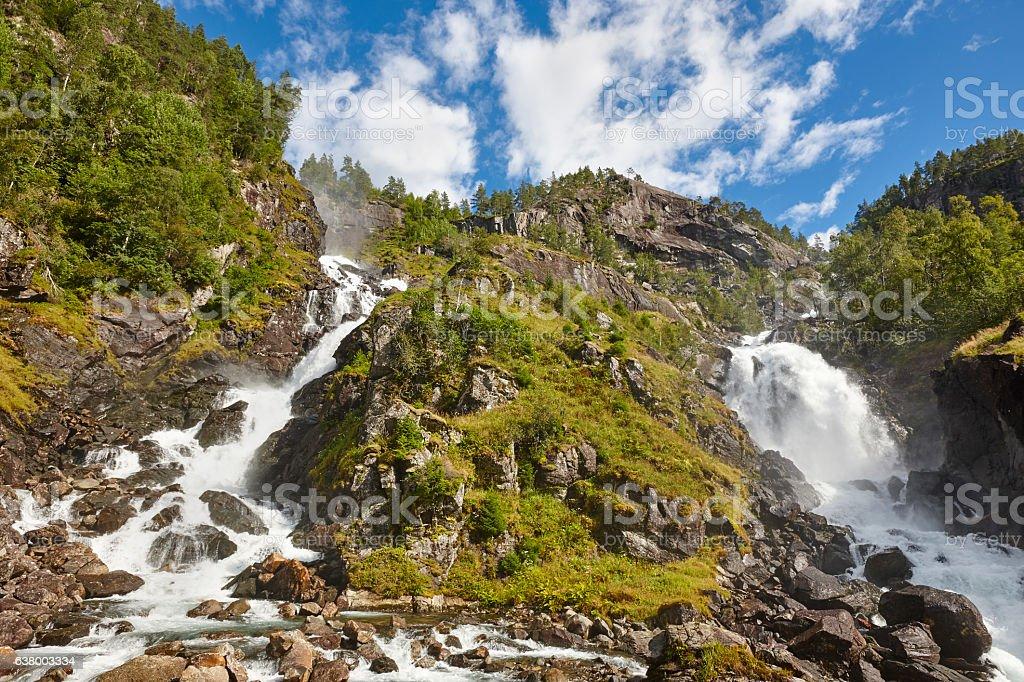 Norwegian twin waterfall. Rocky forest landscape. Latefossen. Vi stock photo