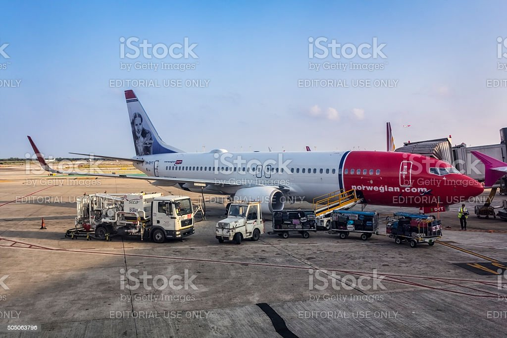 Norwegian.com airplane on the airport stock photo