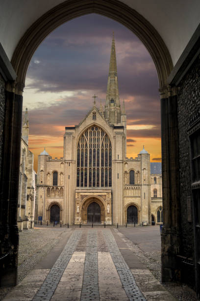 Norwich cathedral at dusk framed by doorway at main entrance stock photo