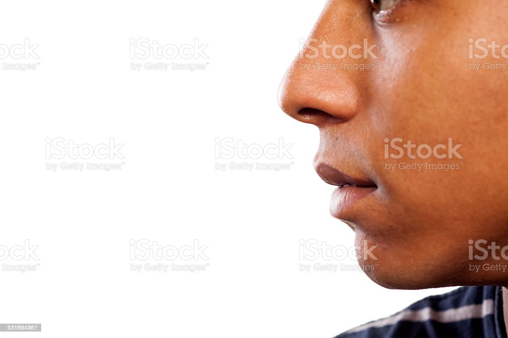 Nose and mouth of a dark-skinned young man stock photo