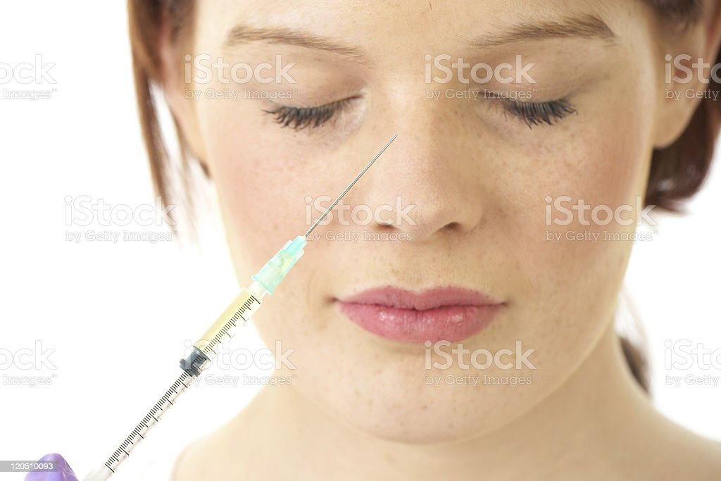nose botox injection, young female face isolated on white stock photo