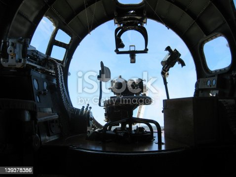 A silhouette shot of a B-17 WWII nose gunner station.