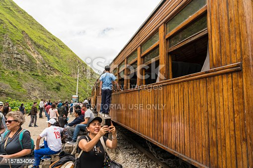 Alausi, Ecuador - March 2, 2019: Ride by old train Nariz del Diablo in green landscape. Visible some tourists  photographing.