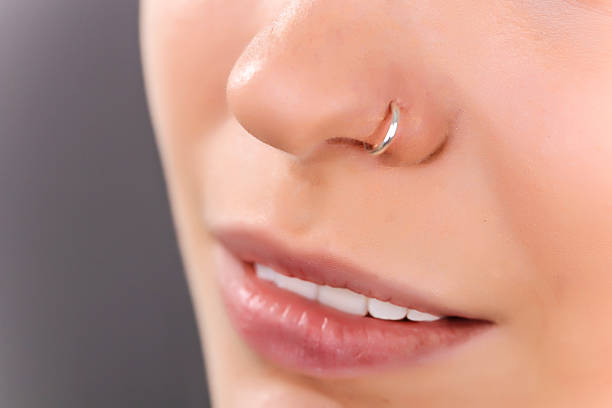 nose piercing - nose ring stock pictures, royalty-free photos & images