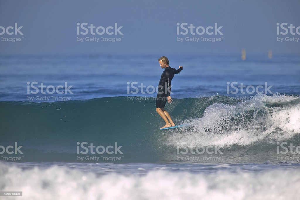 Nose Riding Surfer stock photo