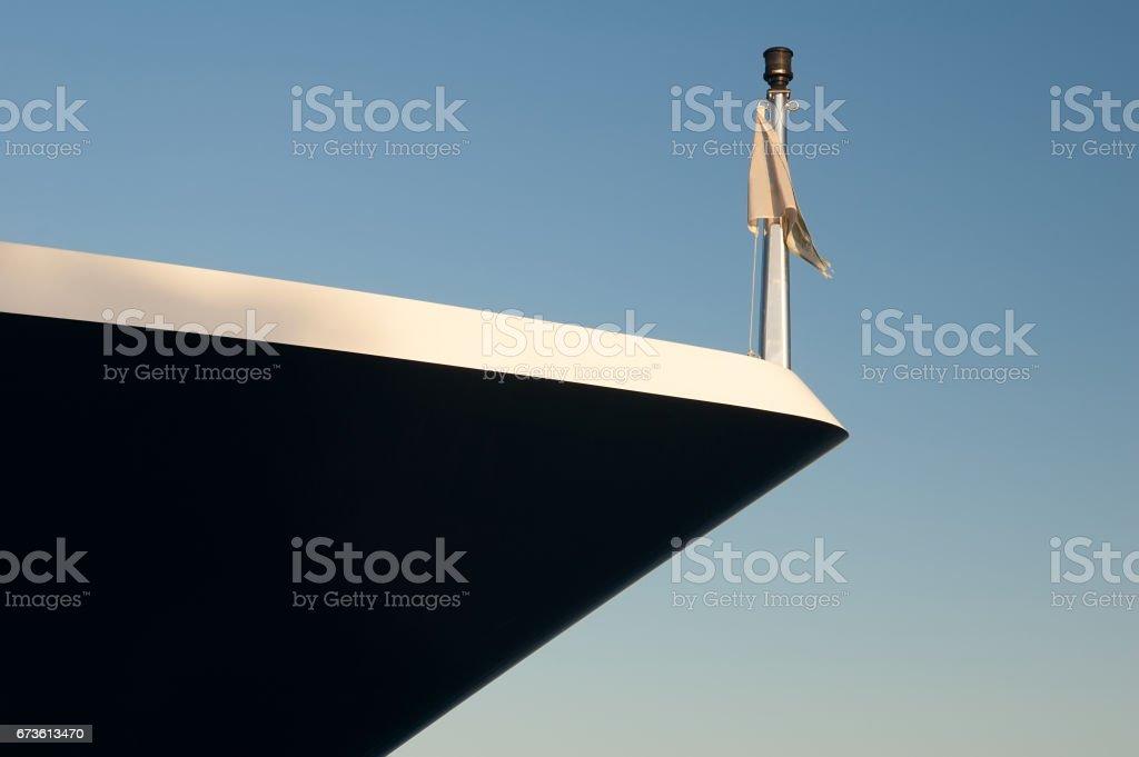 Nose yacht on the blue sky. stock photo