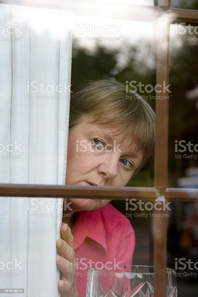 Nosey neighbour at the window stock photo