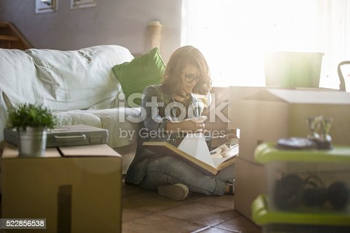 istock Nostalgia looking to an old photo album moving home 522856538