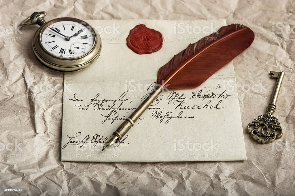 nostalgic background with old letter and vintage ink pen stock photo