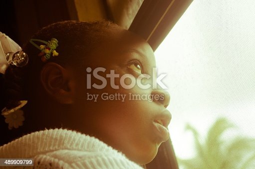 nostalgic girl looking out of window