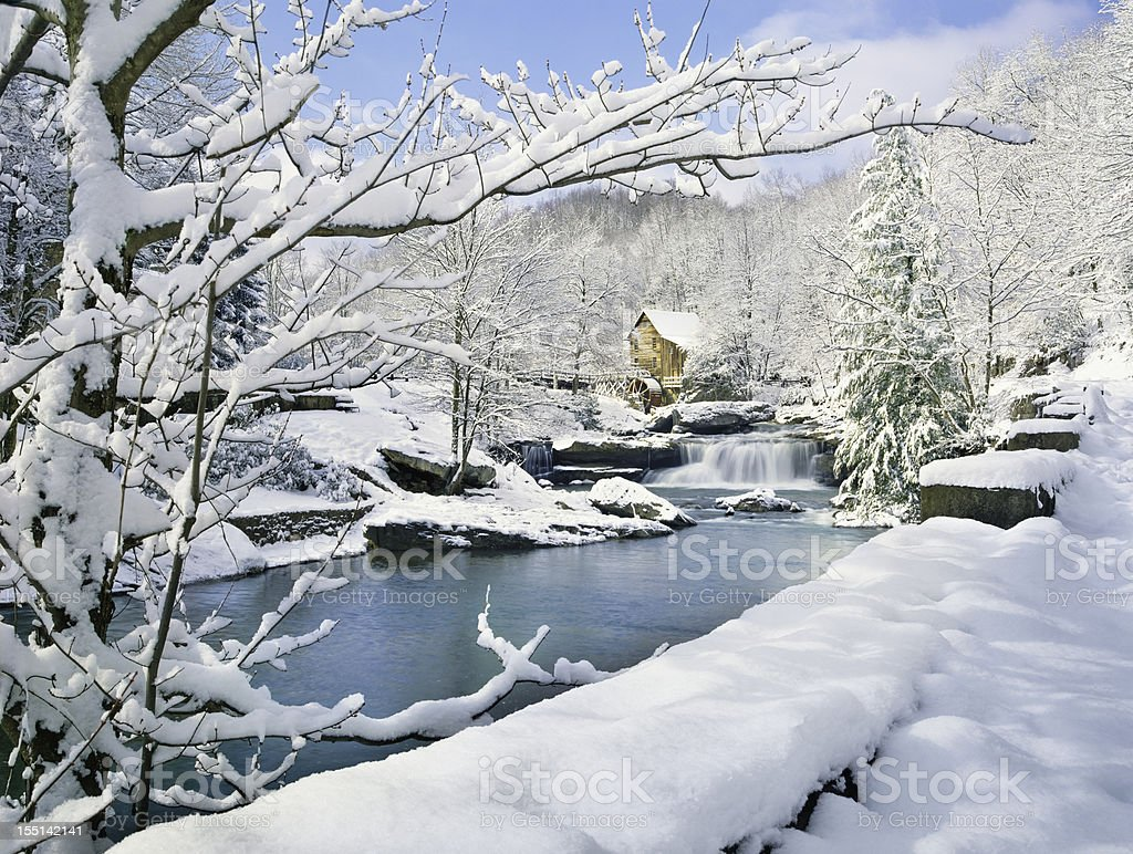 nostalgic gristmill in snowy winter country scene stock photo