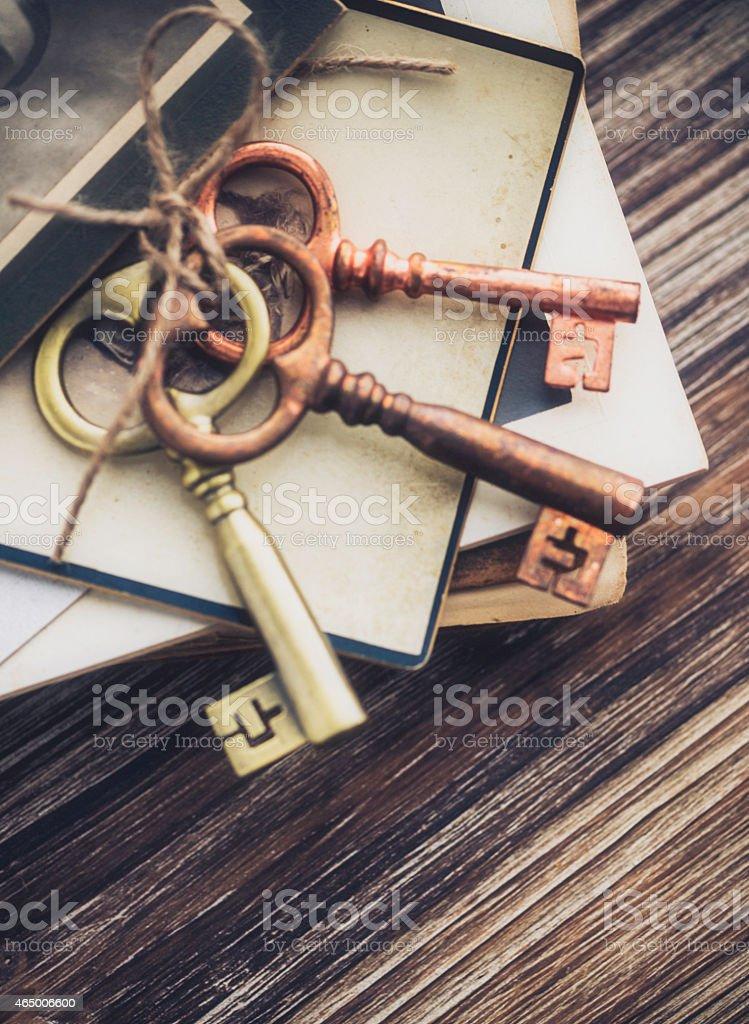 Nostalgic mementos. Old keys, diary and vintage photographs. stock photo