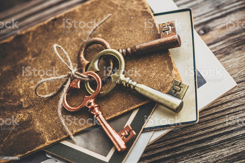 Nostalgic mementos. Old keys, diary and vintage photographs. stock photo