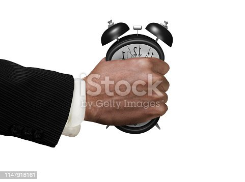Time is not enough concept. Businessman's fist clenched the deformed alarm clock in anger, isolated on white background.