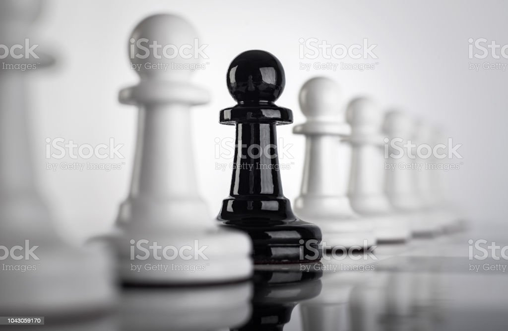 Not like most people. An original idea on the subject of racial, gender and other differences. Racism, LGBT, homosexual chess concept. stock photo