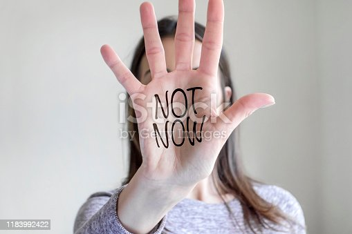 "woman showing her palm quoting ""Not now"""