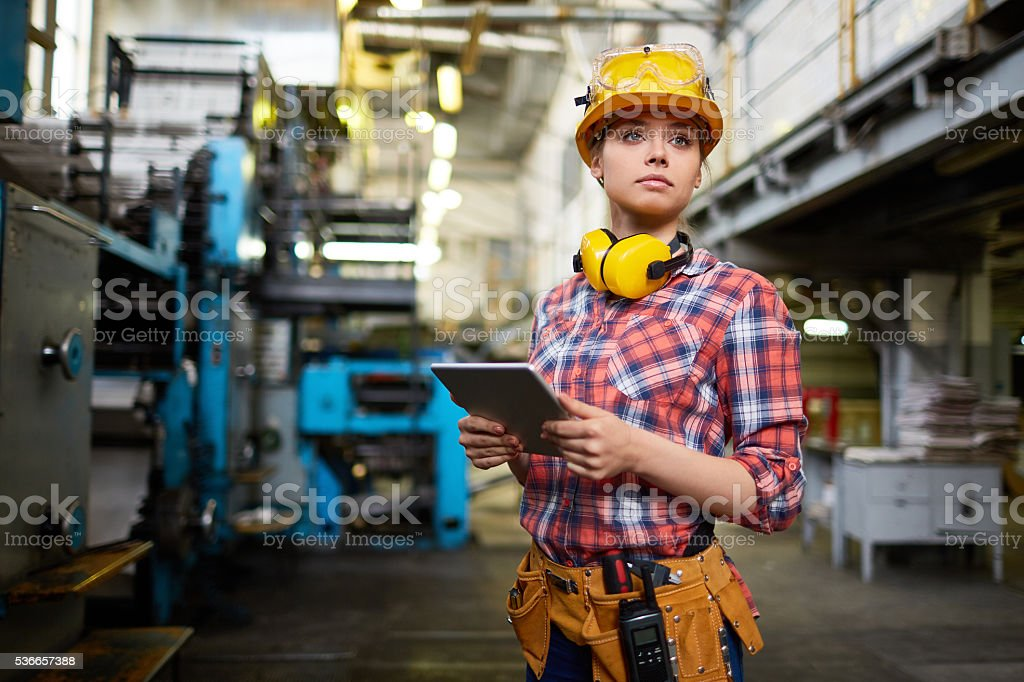 Not only male profession Pretty female student doing practical work at factory Adult Stock Photo