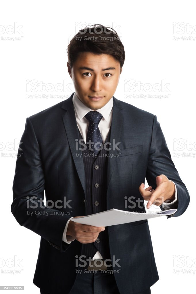 Not so happy businessman with papers stock photo