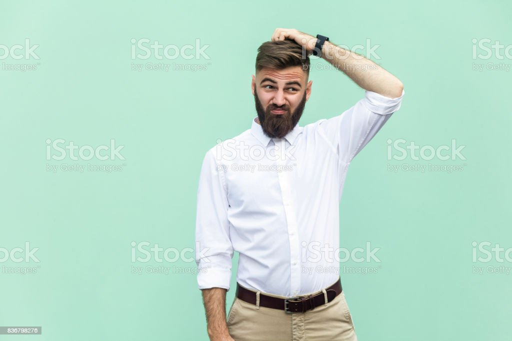 Not sure. Young adult businessman have a doubt. stock photo